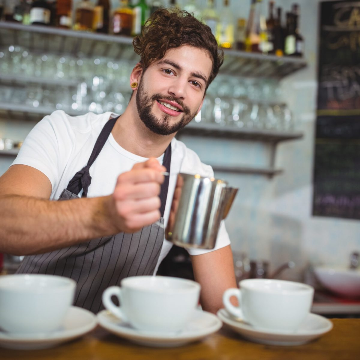 guy making coffees